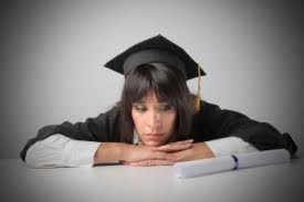 Female high school student looking sadly at diploma