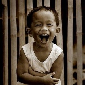Little boy laughing out loud