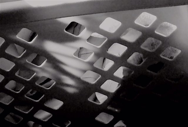 Shadows make even a utilitarian item such as a laundry basket simply striking....
