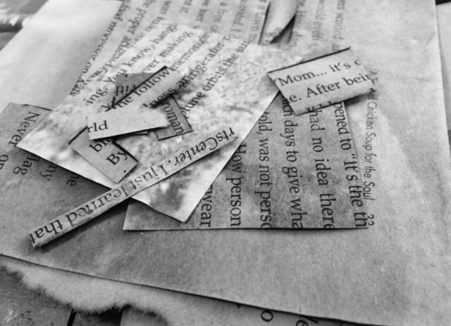 Black and white photo of words on book pages