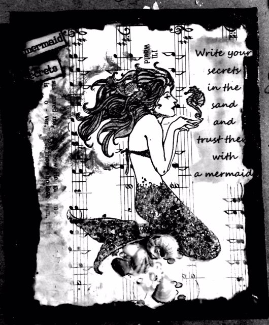 black and white image of a mermaid
