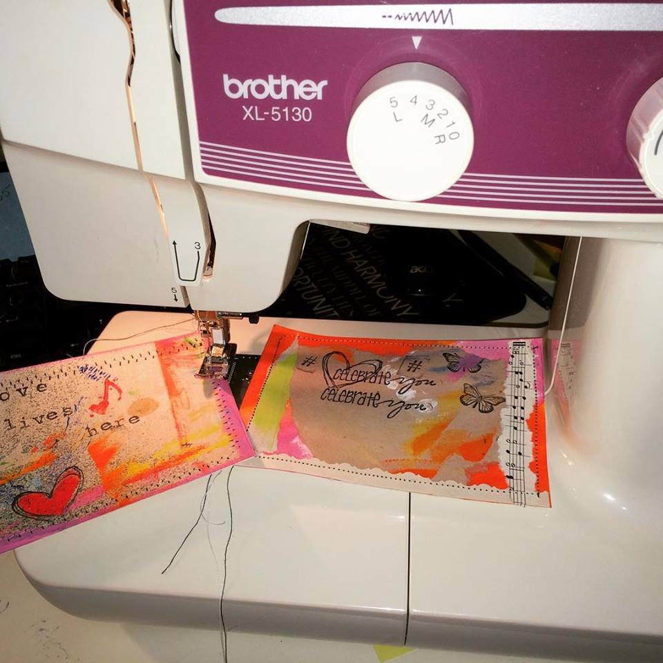 handcrafted postcards being stitched on a sewing machine