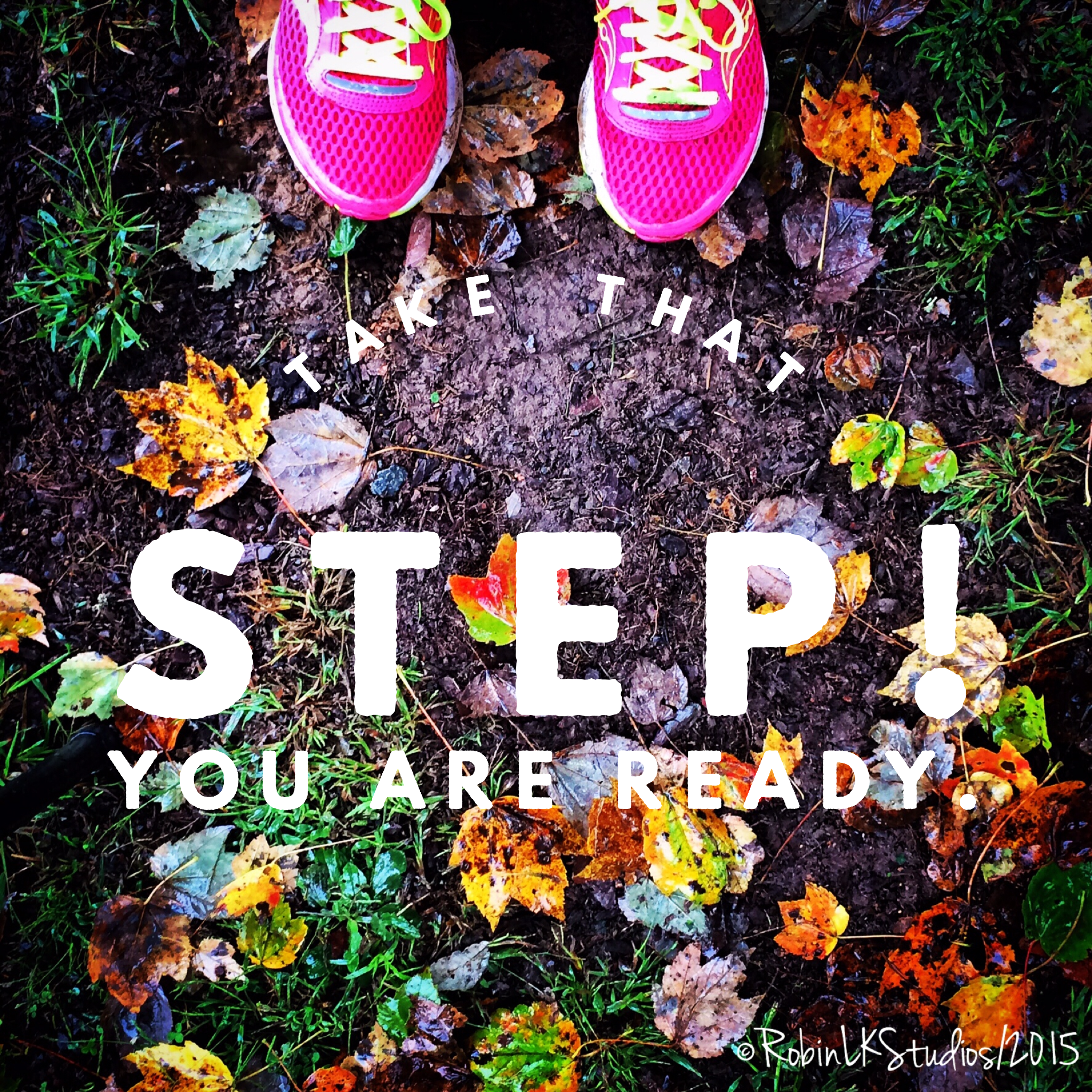 pink running shoes and fall leaves on the muddy ground