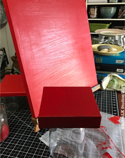 canvases painted red on studio table-underpainting