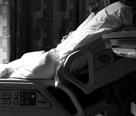 Man lies in hospital bed