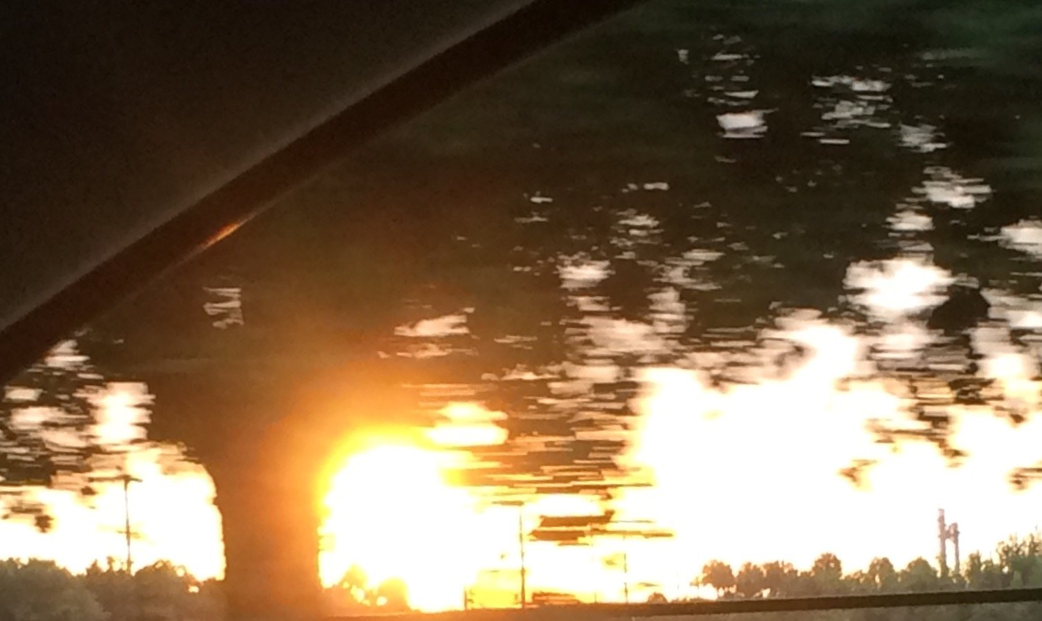 sunrise from a moving car window