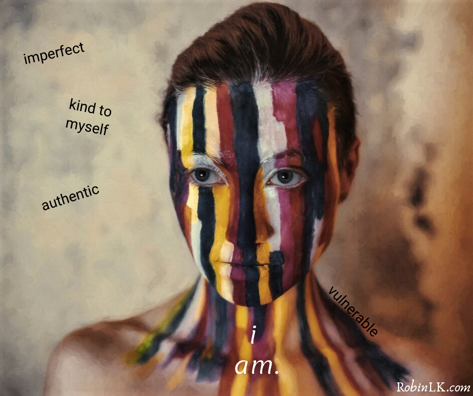 woman's painted face with affirmations around her