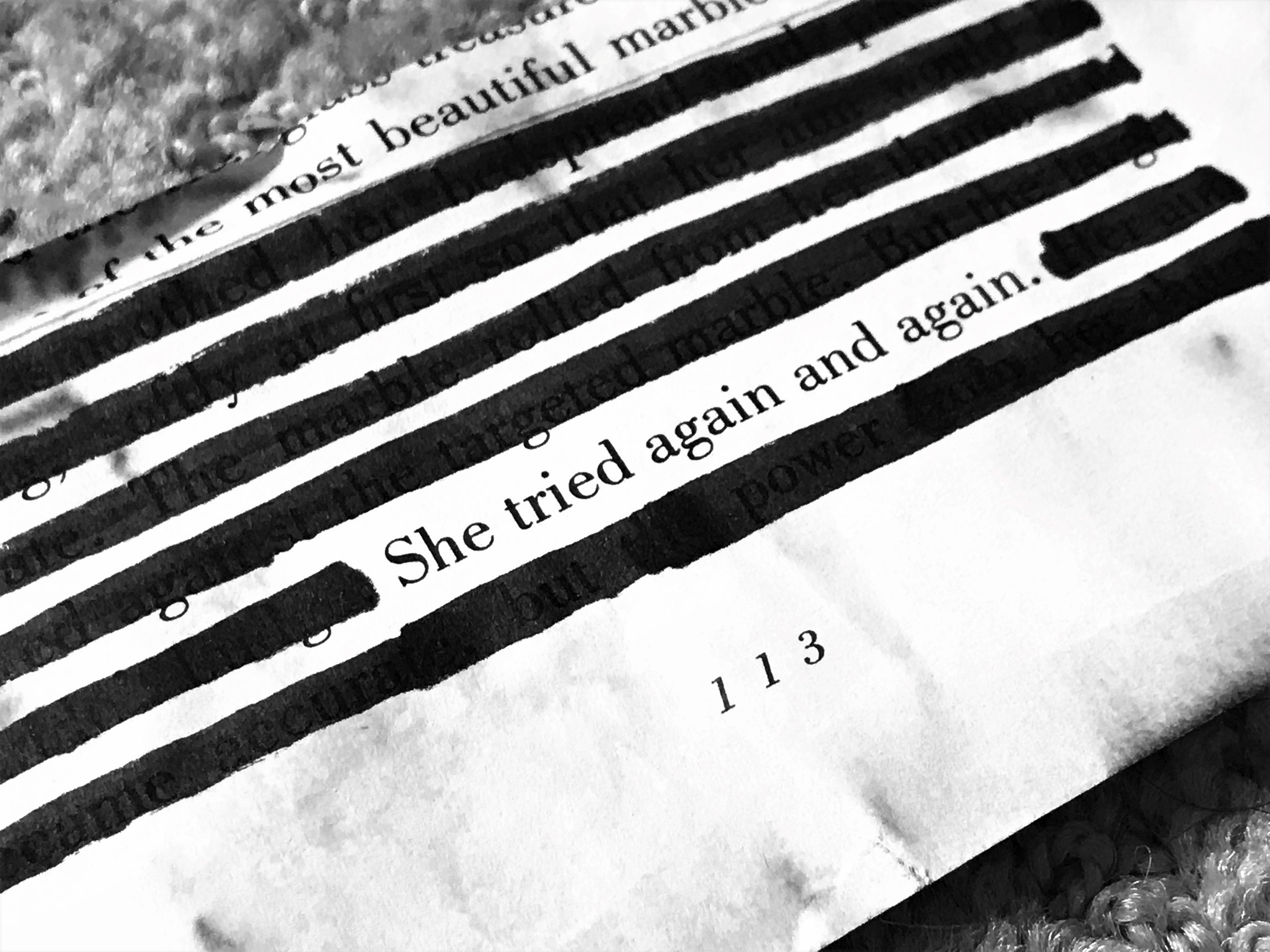 words on a page She tried again and again.