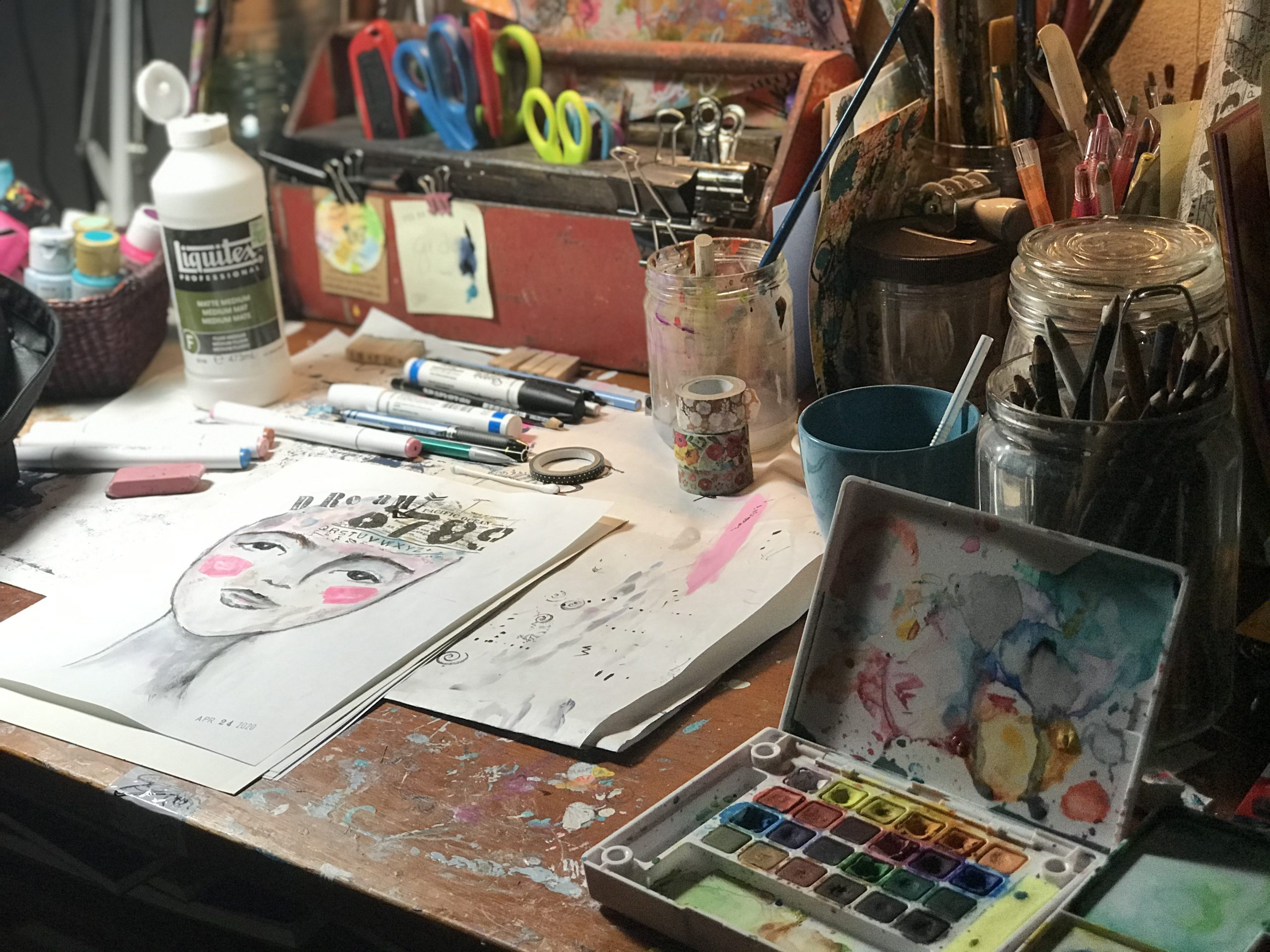 art studio worktable with supplies for making a face