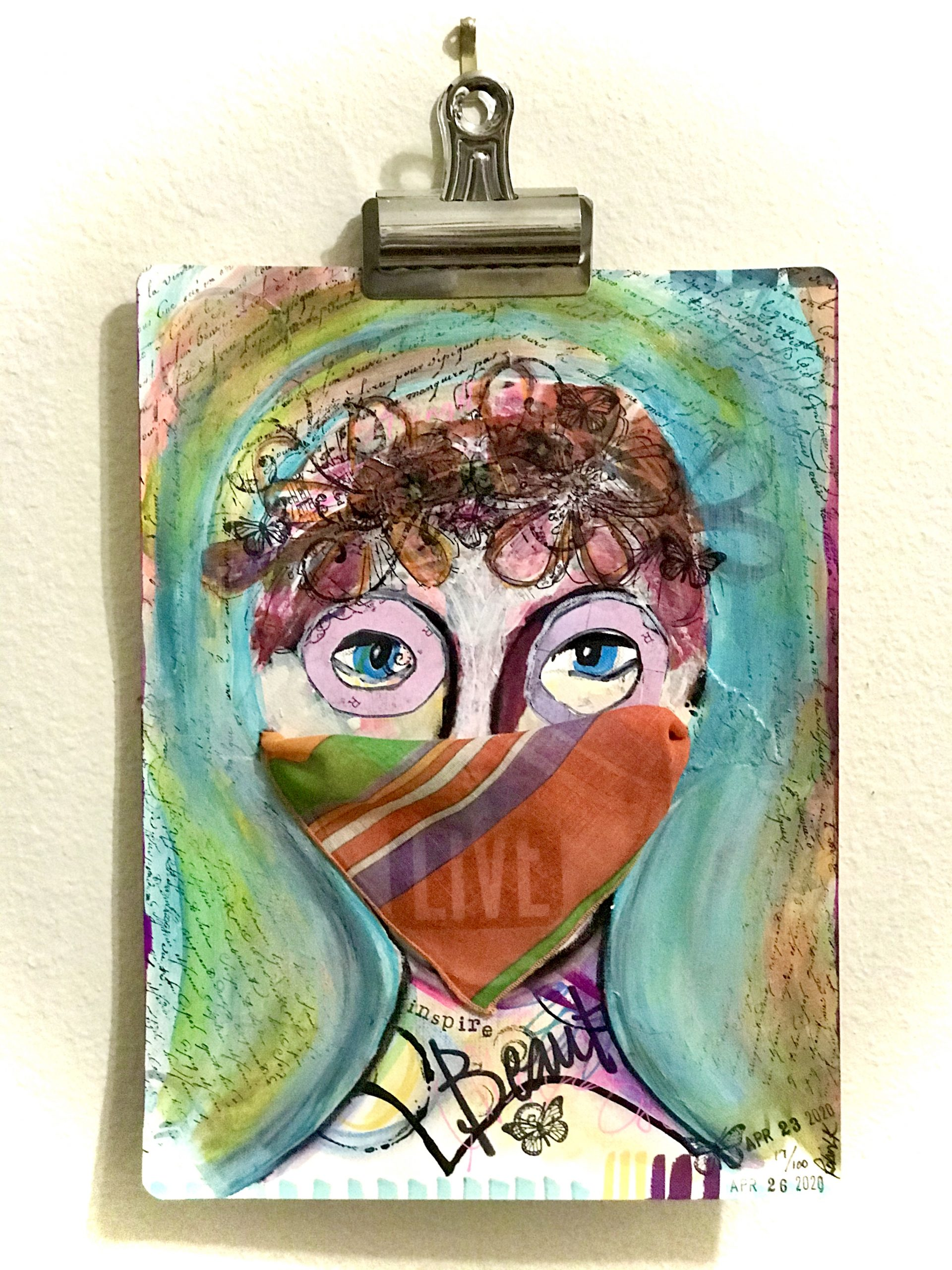 mixed media face with a mask