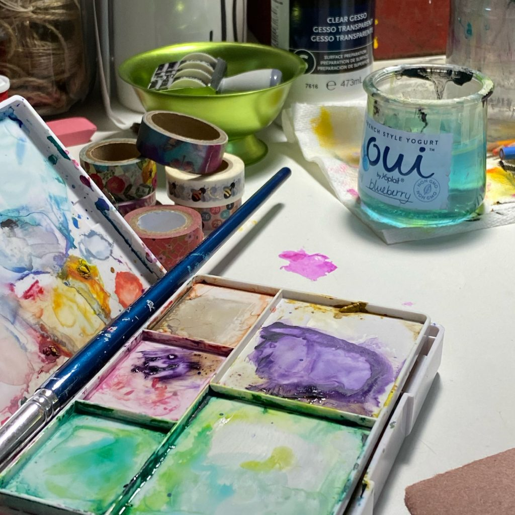 watercolors on an art table