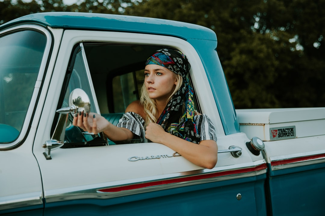 woman in a vintage truck